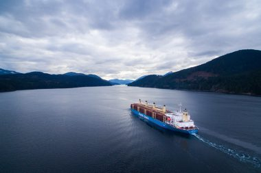 A ship loaded with raw logs leaves the Alberni Inlet on Vancouver Island.